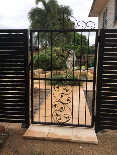 SCROLL FEATURE SLAT GATE AND PANEL